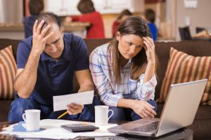 couple struggling with debt and bills